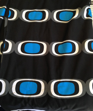 Black fabric with print with blue, black & white ovals